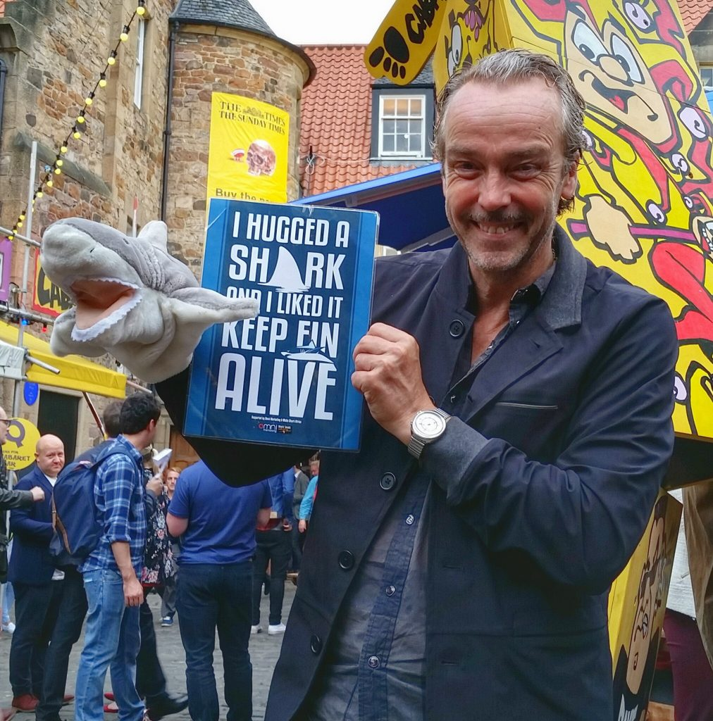 Actor John Hannah poses with Fin