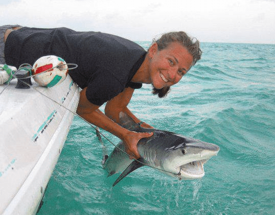 Dr. Kristine Stump with a juvenile Tiger Shark