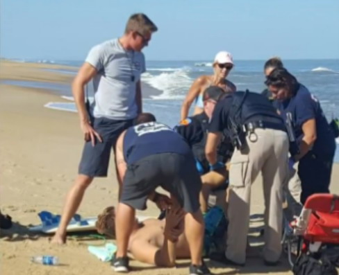 The unidentified surfer being treated. Photo: WVEC