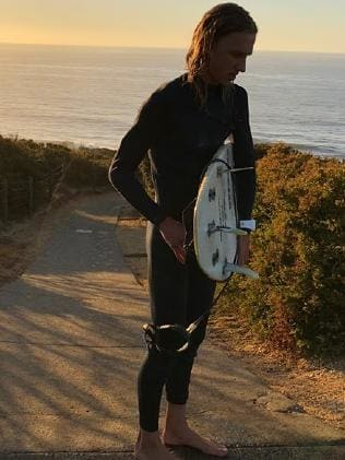 Lachie brown with his surfboard.