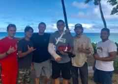 Shark attack survivor Juliun Perkins and his lifesavers.