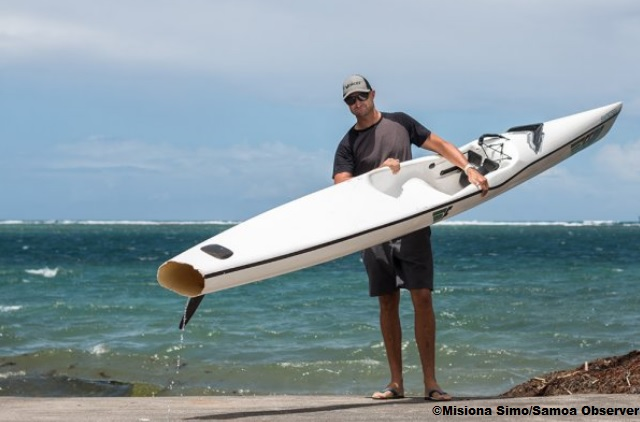 Andrew Wheatley with his shark bitten surfski.